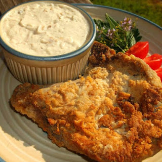 Country Fried Pork Chops With Creamy Milk Gravy.