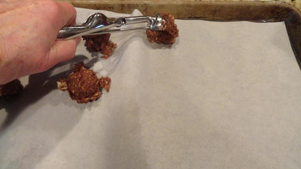 Using a small cookie scoop make evenly sized cookies and place on parchment paper...