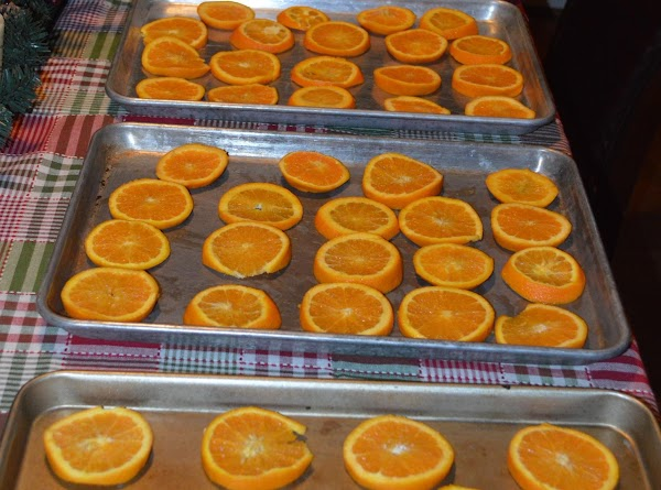 Place on cookie sheets and place in the oven, for 3 hours, flip oranges...