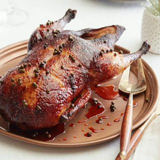 Whole Duck with Green Peppercorn Glaze.