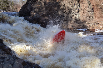 Photo: An unidentified kayaker powers through one of the huge standing waves on the Lester River. When the river is running, Lester River has rapids rated class IV and V by kayakers -- some of the most challenging that can be safely run by boaters based on the International Scale of River Difficulty.