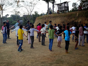 Photo: The IGo youth ministering to the children there at Tening town by playing games with them. Each day during the duration of the conference they would go out to a neighboring villages and minister to the folks there.