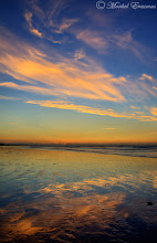 """Photo: """"Flaming Beach"""" Dwarskersbos, West Coast, Western Cape, South Africa  Here's a quick addition to #sunsetsaturday curated by +Dennis Hoffbuhr (and/or +TJ Kelly?)...as well as for #paintitsaturday curated by +Alexius Jørgensen, and lastly for #paintography curated by +Ray Bilcliff, +Gail Beerman and +Sherry McBriar.  The West Coast of South Africa is a place of peculiar beauty, and peculiar taste. Endless stretches of beach varying between fine white sand and grainy shells and pebbles, straddled with rocks and often on the verge of semi-desert terrain, it's a place that has to be experienced by mingling with the homely and often poor people that live and make a living off these waters as fishermen and artisans in the local towns.  On this particular afternoon, the wispy clouds made for an interesting colour palette, very much like a painting by a surrealistic impressionist.  This is a blend of 2 exposures to tame the dynamic range.  #landscapephotography  #seascapesunday   www.morkelerasmus.com www.saffascapes.blogspot.com"""