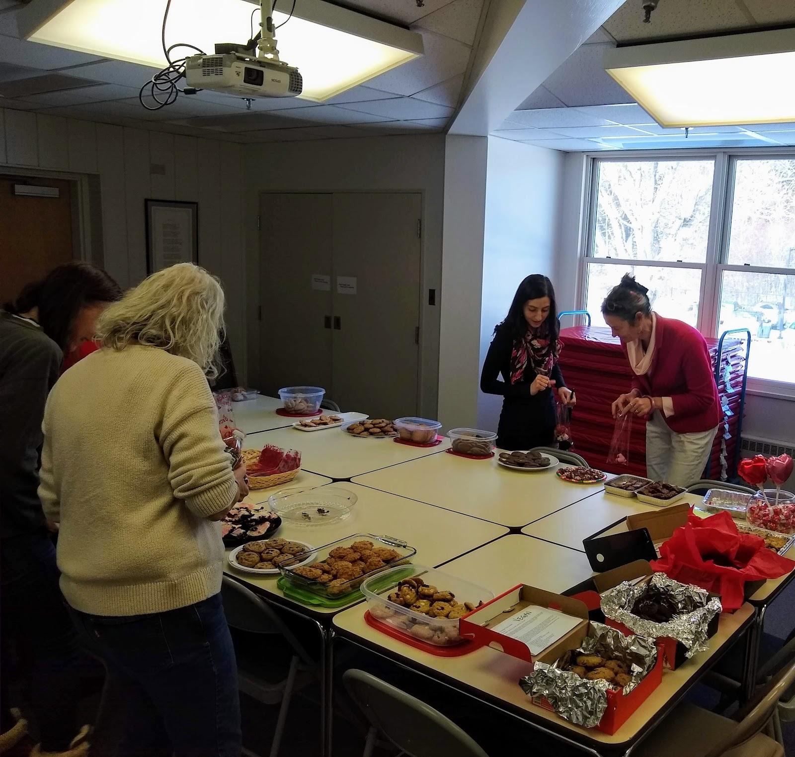 staff choosing valentine treats sponsored from the PTO