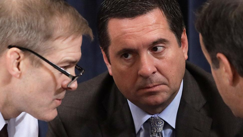 WASHINGTON, DC – DECEMBER 09: Ranking member of House Intelligence Committee Rep. Devin Nunes (R-CA) (C) listens to Rep. Jim Jordan (R-OH) during a break in an impeachment hearing before the House Judiciary Committee in the Longworth House Office Building on Capitol Hill December 9, 2019 in Washington, DC. The hearing is being held for the Judiciary Committee to formally receive evidence in the impeachment inquiry of President Donald Trump, whom Democrats say held back military aid for Ukraine while demanding they investigate his political rivals. The White House declared it would not participate in the hearing.