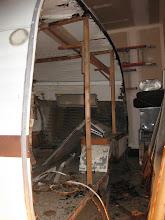 Photo: Another shot with the left wall removed, more rotted wood on the floor than there was on the wall.