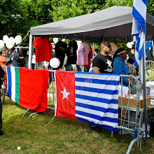 Photo: Free West Papua Campaign stand with info, petition, music, balloons and coffee, opposite the entrance of the Veterans' Day field (photo: Fam. Pentury)