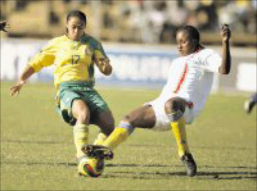 MY BALL: Basetsana's Lusinda Bowers fights for the ball with Kiuvu Diampassi of DR Congo during the Fifa Under-20 Women World Cup qualifier match at Caledonian Stadium in Pretoria. Basetsana won 3-1. Pic. Veli Nhlapo. 01/06/08. © Sowetan.