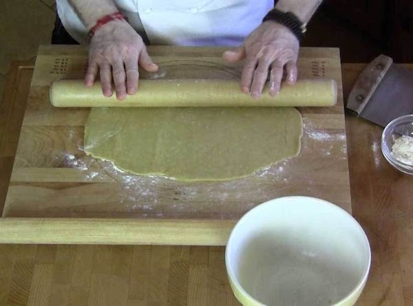 When the dough has risen, roll out on a lightly floured surface, to about...