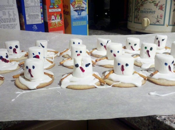 Put white frosting on the odd shaped cookies.  Place a whole (or cut...