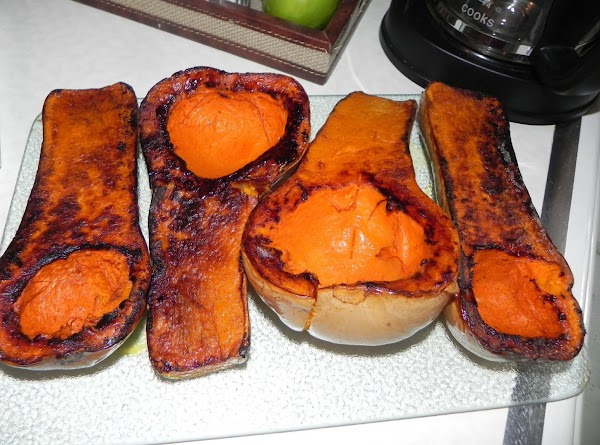 Rinse your butternut squash, slice in half and scoop out seeds. Lay flesh side...