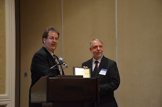 Photo: Dan Rickman (incoming SRSA President) presents Doug Woodward with a plaque for his term as President