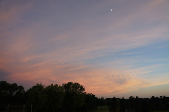 Photo: The cresent moon is clearly visible at sunset.