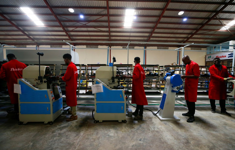 Workers operate machines at a Bata shoe factory in Abuja, Nigeria. Picture: REUTERS/AFOLABI SOTUNDE