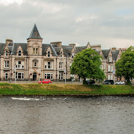 RIVER NESS  by Jennifer  Loper  - Buildings & Architecture Office Buildings & Hotels ( inverness, clouds, spires, trees, three story building, river ness, scotland )