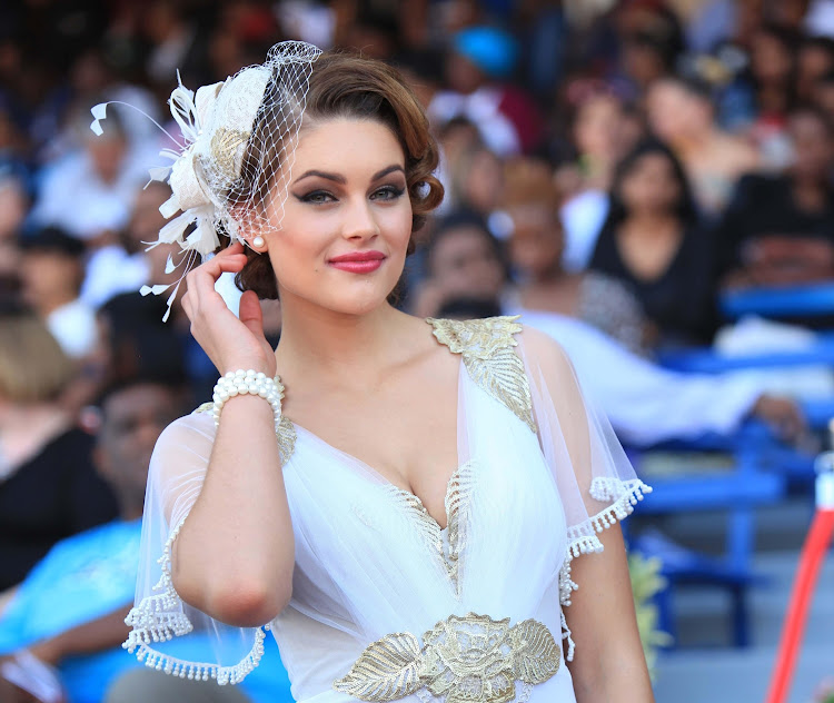 Former Miss SA Rolene Strauss complemented her Anele Botha dress with a matching fascinator at the 2014 Durban July.