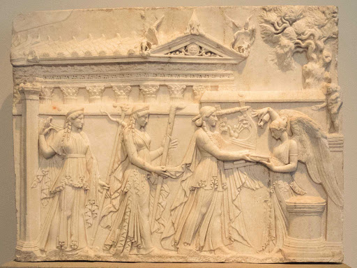 The gods Apollo, Diana and Latona approach an altar where Victoria stands in this marble relief. It dates to 20-30 B.C. at the Altes Museum in Berlin.