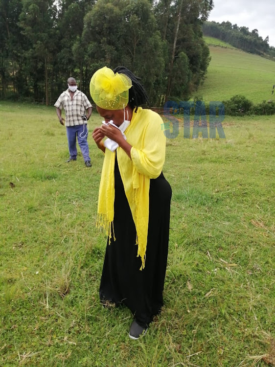 Nyagarama's widow Naomi when she received the body of the governor at Riamanoti Primary School on December 24, 2020.