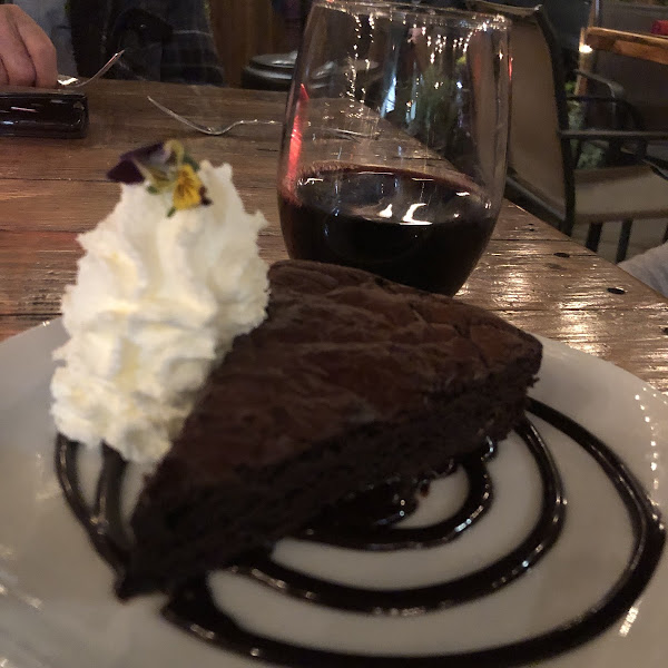 Brownie with fresh whipped cream and wine so amazing!