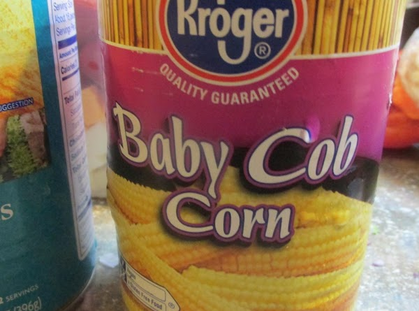 Drain the canned baby corn and cut or break into large chunks, & add...