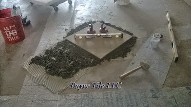 Photo: A marble mud-set installation is a slow and tedious process, but in many situations it is the best route to a beautiful floor. It is not a simply process and not recommended for the DIYer or inexperienced tile setter.