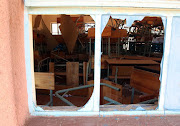 January 06 2019: Broken desks could be seen through broken windows inside classrooms at Senwane Secondary School in Kgalakwena village outside Mokopane, Limpopo, which resembles a dumping site. The school is one of three which produced a zero percentage in the matric examinations.