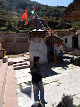 "Photo: Sacred Nandadevi temple at Lata Village. Read a lot about this temple in ""The Nandadevi affair"" . Infact this book is the sole inspiration for this trek. The holy water they offer to goddess here is ""Alchohol""(pretty pure form, i would say).  A lamb was beheaded right infront of my eyes here. Jus reminded me tht i was a die-hard non vegetarian. Overall , looking back at this trek , i still retain the feel of this location."