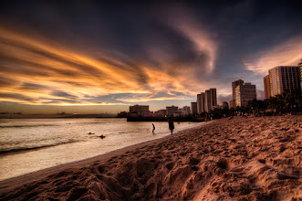 Photo: Falling Away  This is from the beaches of Honolulu in the Waikiki Area where you really do feel like your either in Miami or Las Vegas. The Hotels and shops line the strip which ultimately is an amazing beach lined area for sun bathing between shopping and eating. On this evening my mom and I went for a little photo walk and luckily the skies cooperated with us.  Processing: Nikon D90   Tokina 11-16mm   Photomatix   Photoshop   Topaz