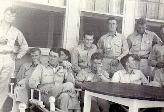 """Photo: At the """"O"""" Club, Tom McMaster (Legs crossed, forefront) Senior Officer at Chase Field 1945"""