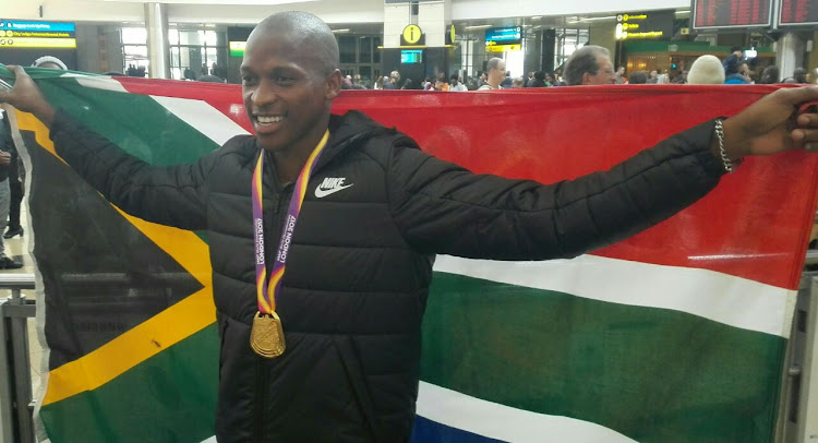 Luvo Manyonga arrives at OR Tambo International Airport.