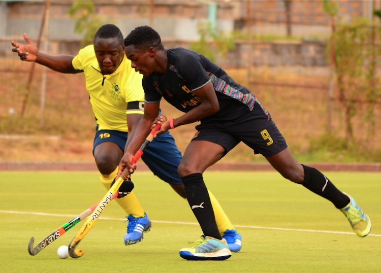 Haggai Pepela of Sikh Union vies for the ball with Strathmore's Brian Ogenche at the City Park Stadium in a past match.