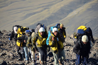 Photo: Kurdish porters carrying equipment with their noticeable yellow jackets purchased for the expedition
