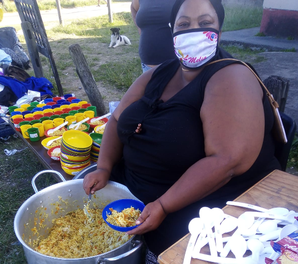 Fynbos resident Pam Orie serves a nutritious meal five days a week to hungry children from the community.