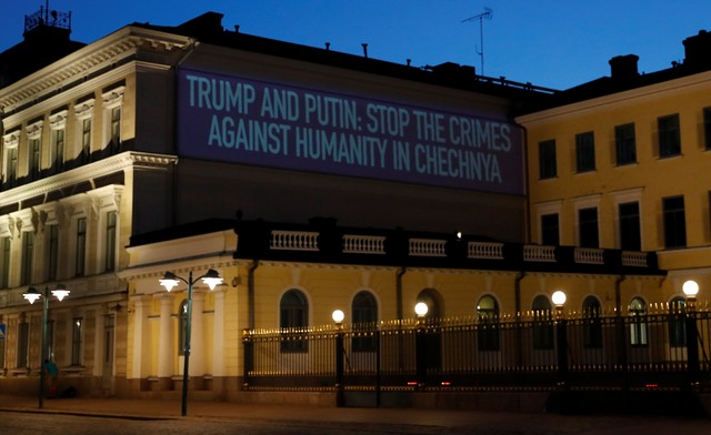 A projection is seen on a wall next to the Presidential Palace in Helsinki, Finland July 15, 2018.