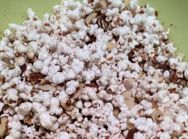Mix popped corn, pecans and almonds in a large bowl or pan.