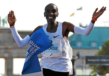 230fe6cfbaf1b Moment of greatness  Eliud Kipchoge crosses the finish line in Berlin