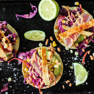 Fresh Tuna Fish Tacos with Adobo Crema & Red Cabbage Slaw.