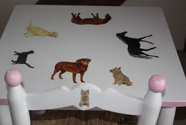 a children's table with various animals painted on it