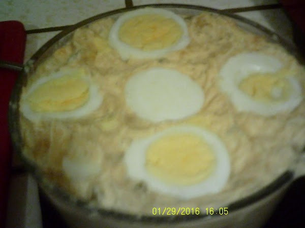 Place mixture in serving bowl.  Top with other sliced egg.  A sprinkle...