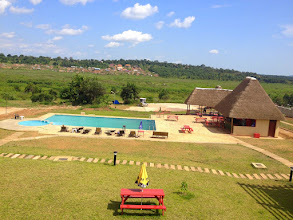 Photo: Our hotel in Kampala (we stay in the camp across the pool)