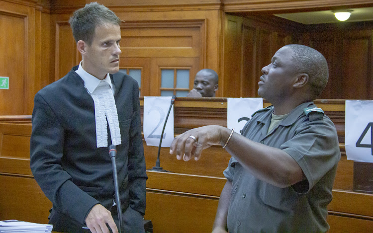Sergeant Minye (right) explains how he tracked the alleged killer Blessing Bveni (centre) to the state prosecutor Chris Burke (left) in the Cape Town high court in March 2020.