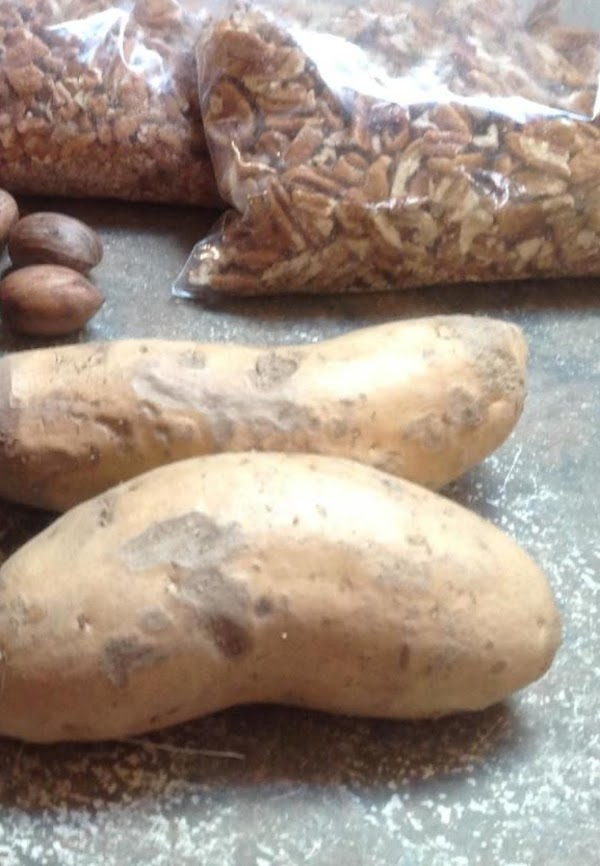 Wash, & peel sweet Potatoes. This is what the whole potato looks like.