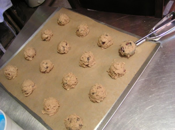 Line baking sheets with parchment paper. Scoop up rounded tablespoons of cookie dough and...