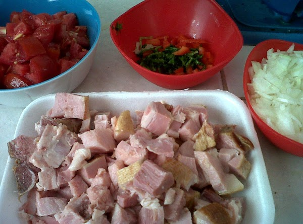 cut the onion, tomatoes, pork chops, and red pepper.
