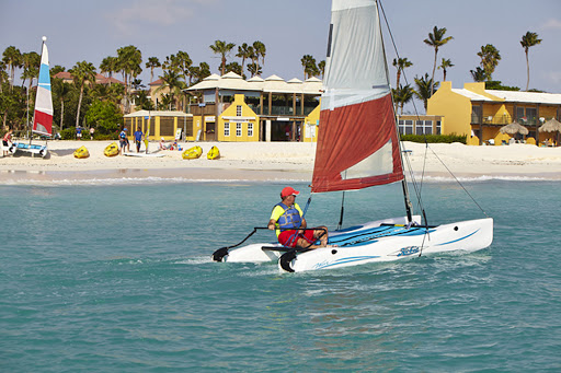 Tamarijn-Aruba.jpg - A visitor takes a small catamaran out for a spin in front of Tamarijn Aruba, a laid-back, all-inclusive resort.