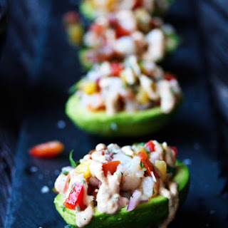 Pineapple and Prawn Salsa on Avocados with Cashew Sriracha Cream.