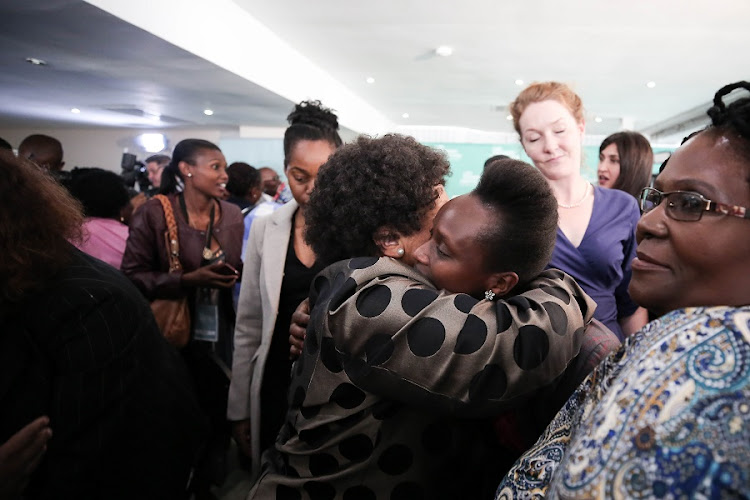 Family members celebrate in Parktown after former Deputy Chief Justice Dikgang Moseneke ordered that the government pay R1.2 million to affected families. Picture: ALAISTER RUSSELL/SUNDAY TIMES