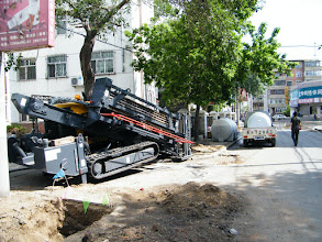 Photo: a drill machine operating near Qiqihar railway southern residential area, where large scale ground breaking for new wire landing.