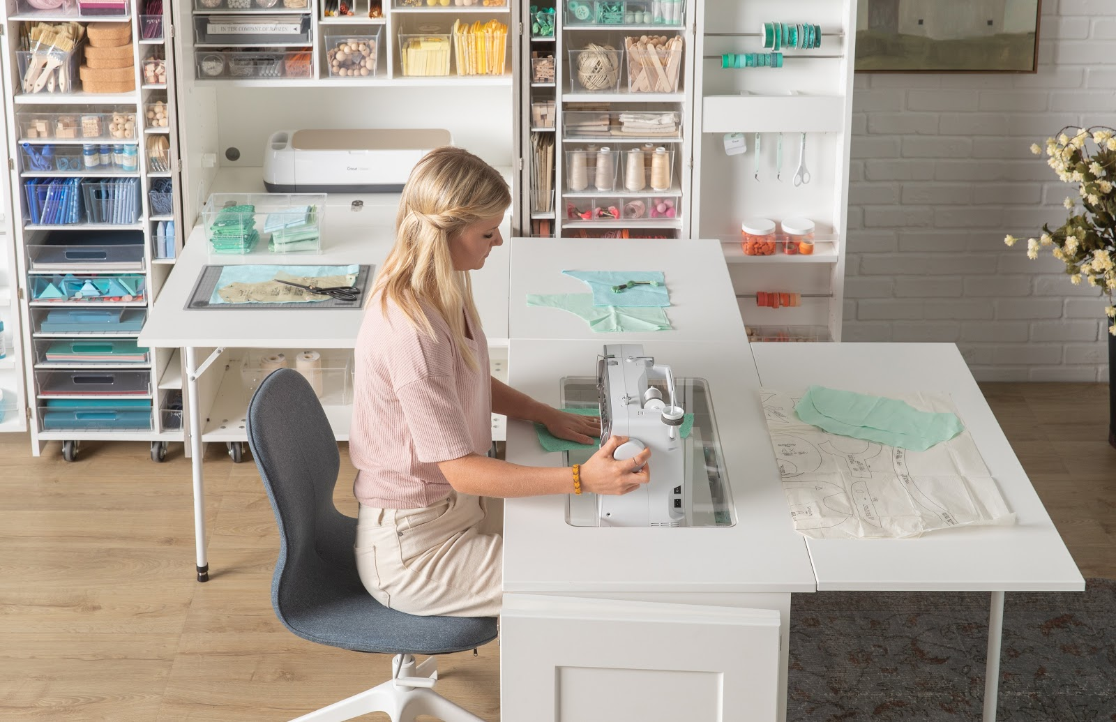 Blonde lady sitting at a Sew Station