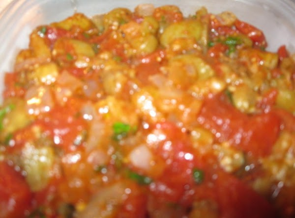 Saute the eggplant in olive oil until golden brown, remove and keep warm in...